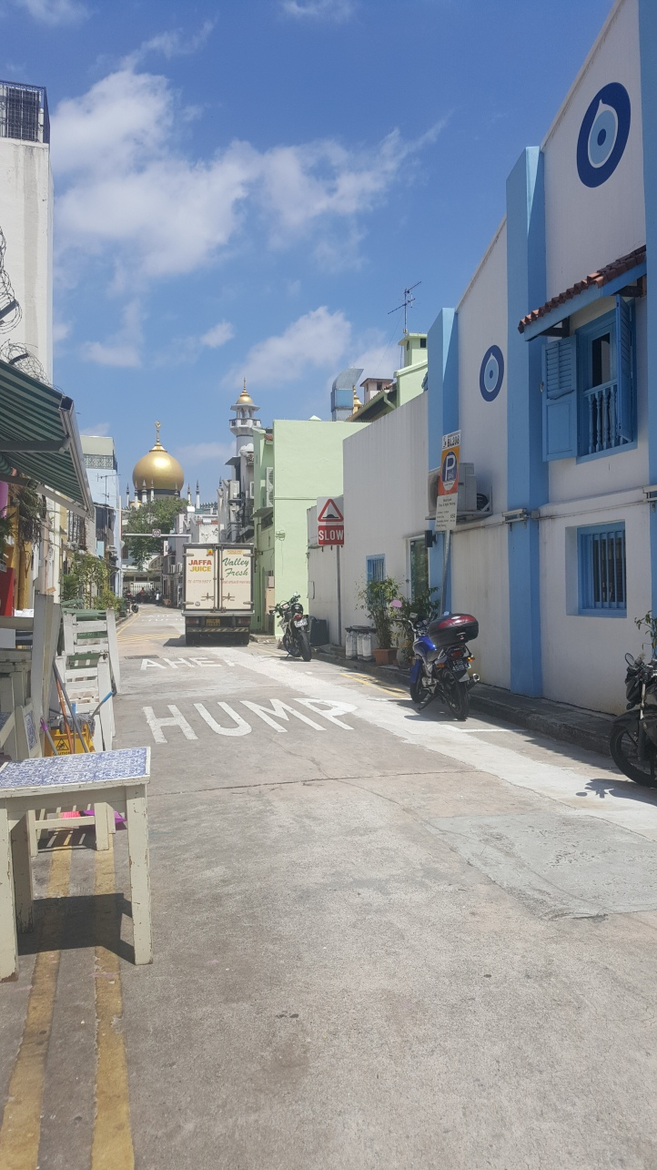 The Sultan Mosque at the end of this Chefchaouen looking street.