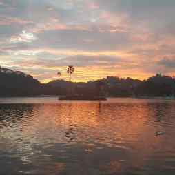 Sunset over Kandy Lake.