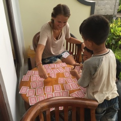 A serious game of pairs with the owner's children.