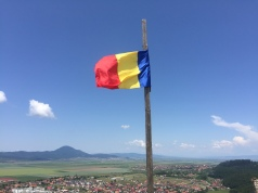 Flag of Romania at the top.