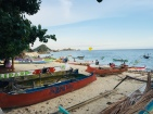 Fishermen's boats and kite flying in Kuta.